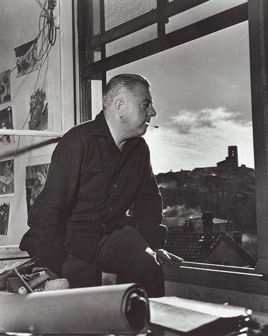 Jacques_Prevert_sitting_at_a_window_Vence_1953